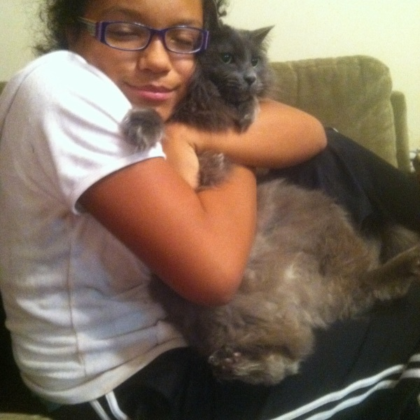 """Submitted by Gudrun:  """"This is Emily in Georgia with our rescue cat Mini Miez (German for kitty)."""""""