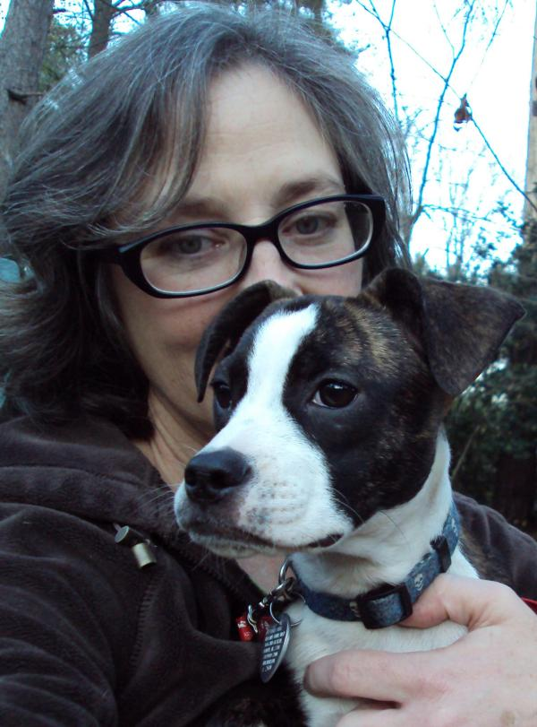 "Submitted by Lisa:  ""This is me with my foster half-Boston Jujube."""
